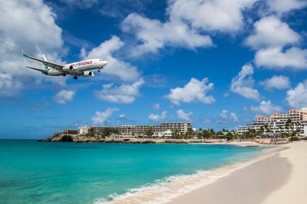plane flying over Maho Beach, St. Maarten