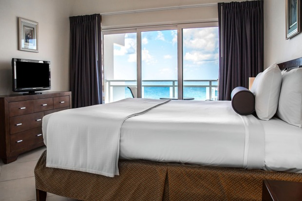 Alegria, an Ascend Hotel Collection Member guest bedroom with view of the beach