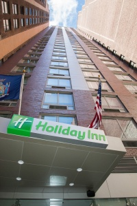 looking up at the exterior of the Holiday Inn Times Square