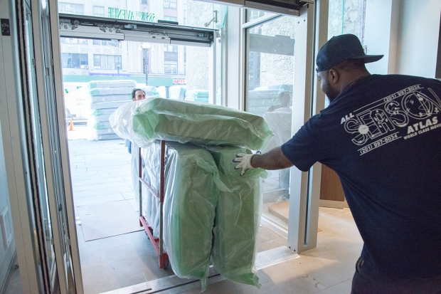 new mattresses being taken into the Holiday Inn New York City – Times Square