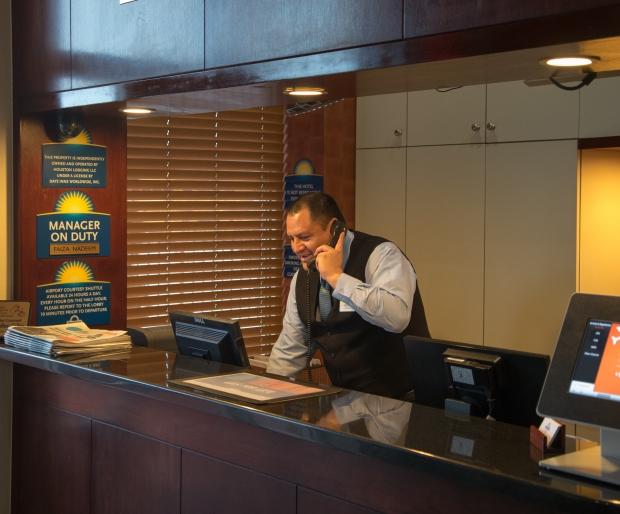 front desk attendant at Days Inn Jamaica JFK Airport